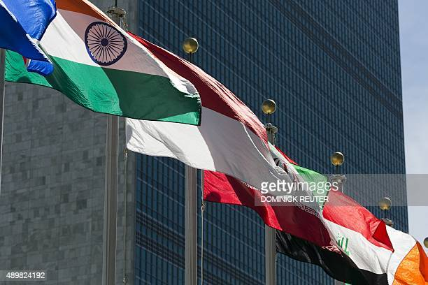 International flags fly in front of the United Nations headquarters on September 24 before the start of the 70th General Assembly meeting AFP...