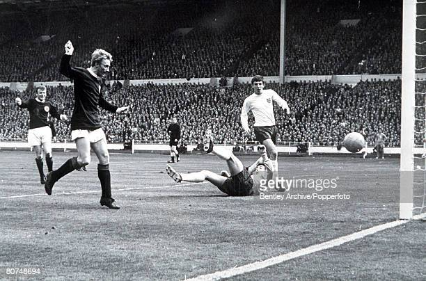 International Football Wembley Stadium England 2 v Scotland 3 Scotland's Denis Law beats England goalkeeper Gordon Banks to score the first goal