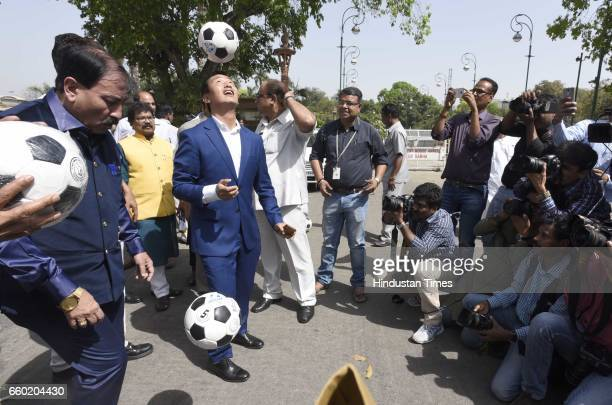 International footballer and Member of Parliament from Howrah Prasun Banerjee and Indian footballer Baichung Bhutia play football during the 'Mission...