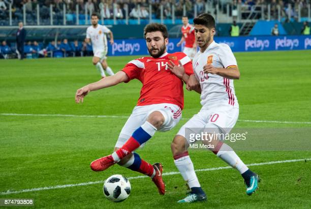 SPAIN International friendly football match at Saint Petersburg Stadium The game ended in a 33 draw Russia's Georgy Dzhikiya and Spain's Marco Asensio