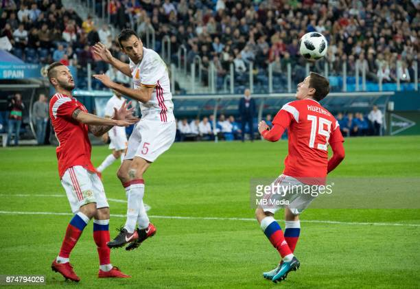SPAIN International friendly football match at Saint Petersburg Stadium The game ended in a 33 draw Russia's Fedor Kudryashov Spain's Sergio Busquets...