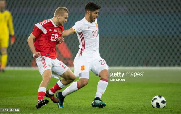 SPAIN International friendly football match at Saint Petersburg Stadium The game ended in a 33 draw Russia's Igor Smolnikov and Spain's Marco Asensio