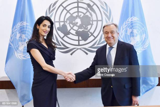International Human Rights Lawyer Amal Clooney and 9th SecretaryGeneral of the United Nations António Guterres shake hands at United Nations...