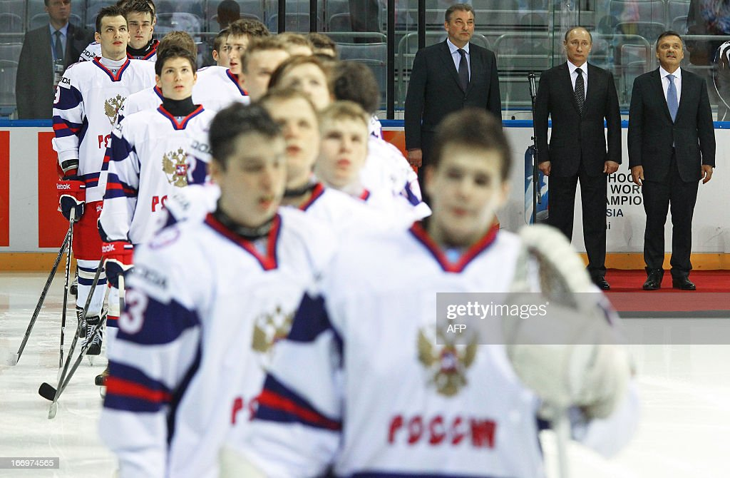 International Ice Hockey Federation chairman, Rene Fazel, Russia's President Vladimir Putin and Russian ice hockey federation president, Soviet hockey legend, Vladislav Tretyak, attend the opening ceremony of the Ice Hockey U18 World Championships, before a Russia-USA game, in the ice arena in the Black Sea resort of Sochi, on April 18, 2013.