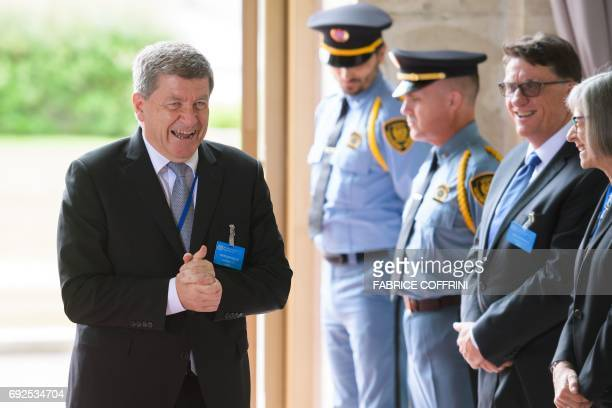International Labour Organization DirectorGeneral Guy Ryder gestures as he waits for Uruguayan President on the opening day of the 106th ILO annual...