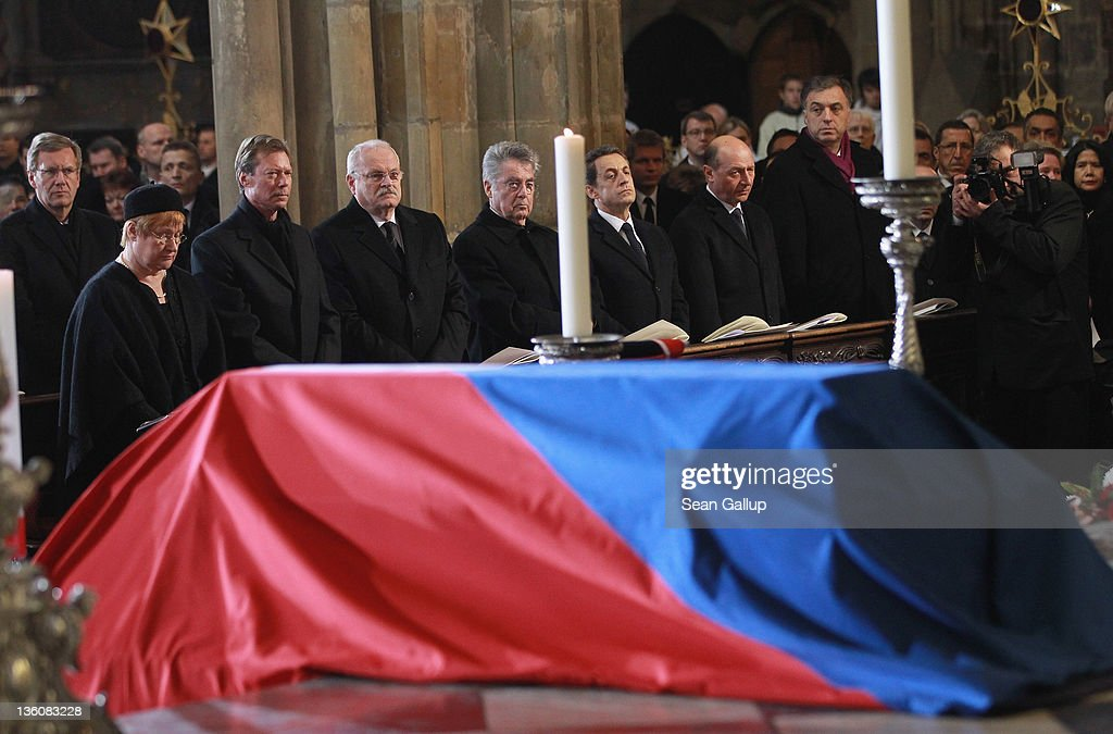 International leaders, including (from L to R) German President Christian Wulff, an unnamed woman, Grand Duke Henri of Luxembourg, Slovak President Ivan Gasparovic, Austrian President Heinz Fischer and French President Nicolas Sarkozy look on as the coffin of former Czech President Vaclav Havel lies draped under a Czech flag at St. Vitus Cathedral on December 23, 2011 in Prague, Czech Republic. International heads of state and thousands of mourners came to pay their last respects to the dissident playwright who led the Velvet Revolution that forced communist rule in Czechoslovakia to crumble in 1989, and died in the early morning of December 18 in his sleep at the age of 75.