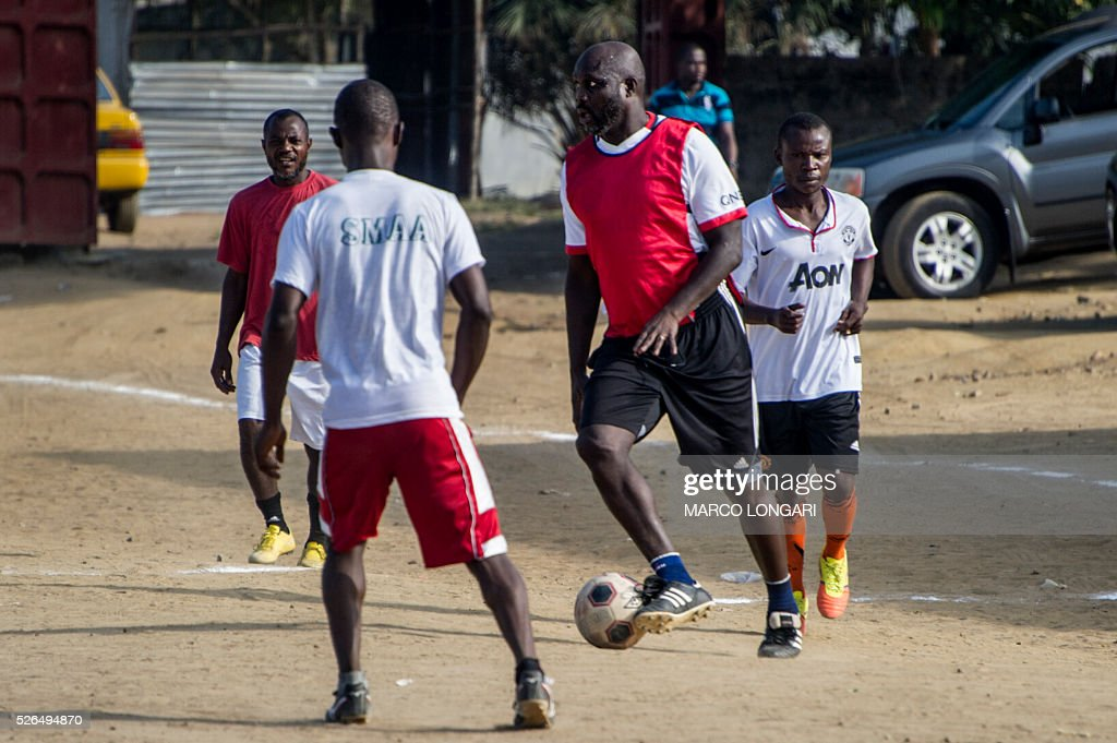 International Liberian soccer star, George Weah dribbles during a match played on a dusty pitch at the Alpha Old Timers Sports Association in Paynesville in Monrovia on April 30, 2016. Former international football star George Weah said on April 28, 2016, he would be a candidate in next year's presidential elections in Liberia, his second bid for the post. / AFP / MARCO