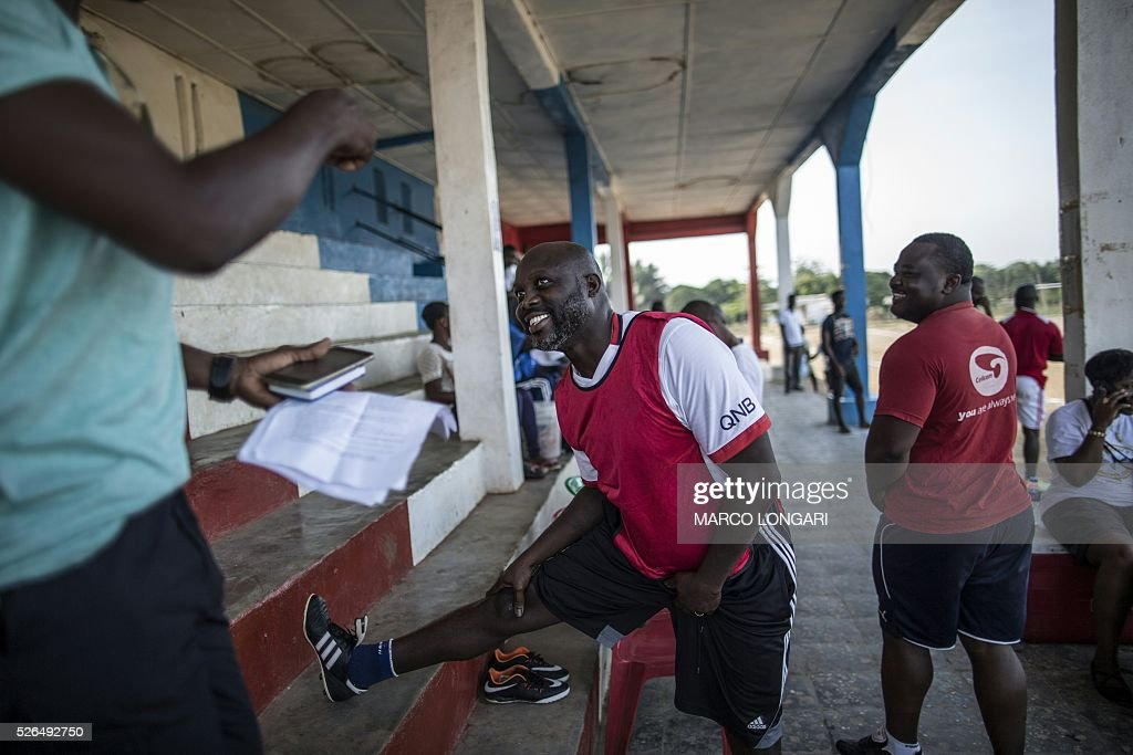 International Liberian soccer star, George Weah warms up prior to a match played on a dusty pitch at the Alpha Old Timers Sports Association in Paynesville in Monrovia on April 30, 2016. Former international football star George Weah said on April 28, 2016, he would be a candidate in next year's presidential elections in Liberia, his second bid for the post. / AFP / MARCO