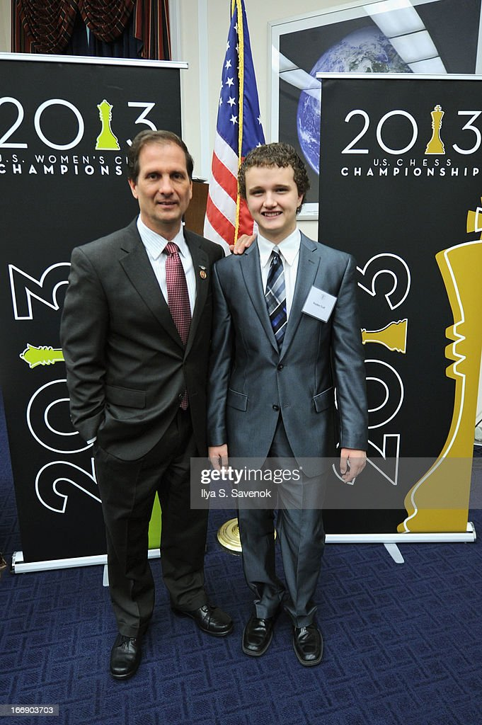 International Master Kayden Troff (R) and Rep. Chris Stewart (R-UT) attend a special event held at United States Capitol Building on April 18, 2013 in Washington, DC.