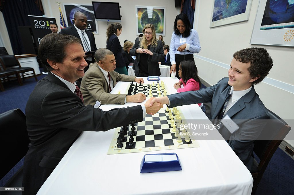 International Master Kayden Troff (R) shares chess tips with Rep. Chris Stewart (R-UT) during a special event held at United States Capitol Building on April 18, 2013 in Washington, DC.