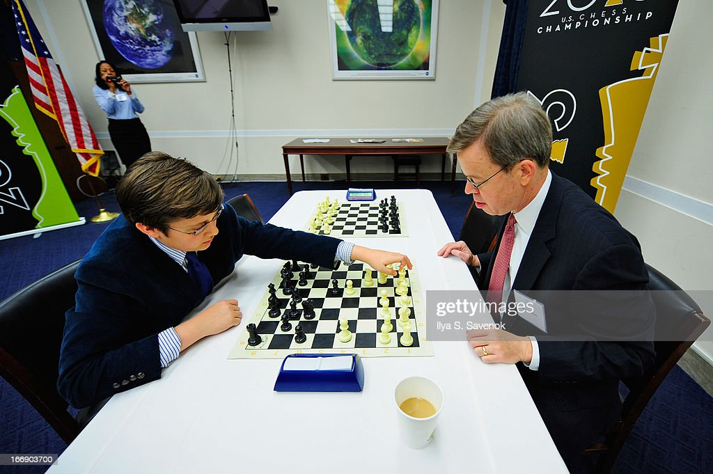 International Master Sam Sevian (L) shares chess tips with former representative <a gi-track='captionPersonalityLinkClicked' href=/galleries/search?phrase=Jim+Talent&family=editorial&specificpeople=534277 ng-click='$event.stopPropagation()'>Jim Talent</a> during a special event held at United States Capitol Building on April 18, 2013 in Washington, DC.