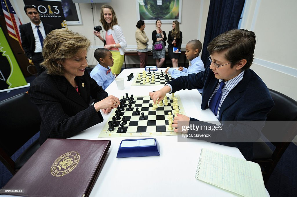 International Master Sam Sevian (R) shares chess tips with Rep. Vicky Hartzler (R-MO) during a special event held at United States Capitol Building on April 18, 2013 in Washington, DC.