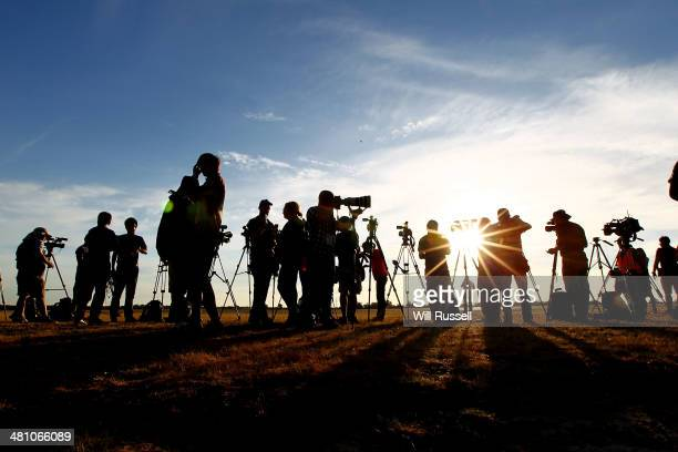 International media await the arrival of a RAAF C17 Globemaster aircraft carrying a Navy Seahawk helicopter at the RAAF base in Bullsbrook on March...