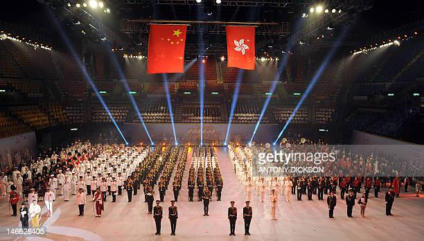 International military bands line up under the national flags of China and the Hong Kong SAR flag during the rehearsal for the International Military...