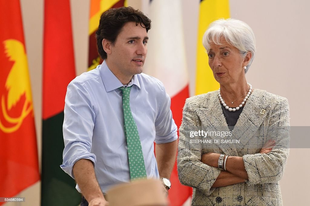 International Monetary Fund (IMF) boss Christine Lagarde (R) chats with Canadian Prime Minister Justin Trudeau as they take part in a dialogue with world leaders at the G7 Summit in Shima in Mie prefecture on May 27, 2016. A British secession from the European Union in next month's referendum could have disastrous economic consequences, G7 leaders warned on May 27 at the close of the summit in Japan. / AFP / STEPHANE