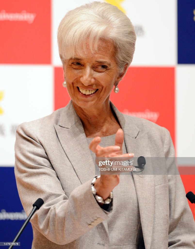 International Monetary Fund (IMF) chief Christine Lagarde gestures while delivering her speech with a theme of 'Leadership for a Global Society: A Discussion with Students at Keio University' at the Mita University campus in Tokyo on July 7, 2012. Lagarde warned that the global economy was slowing, with a soon-to-be published growth outlook lower than earlier forecasts.