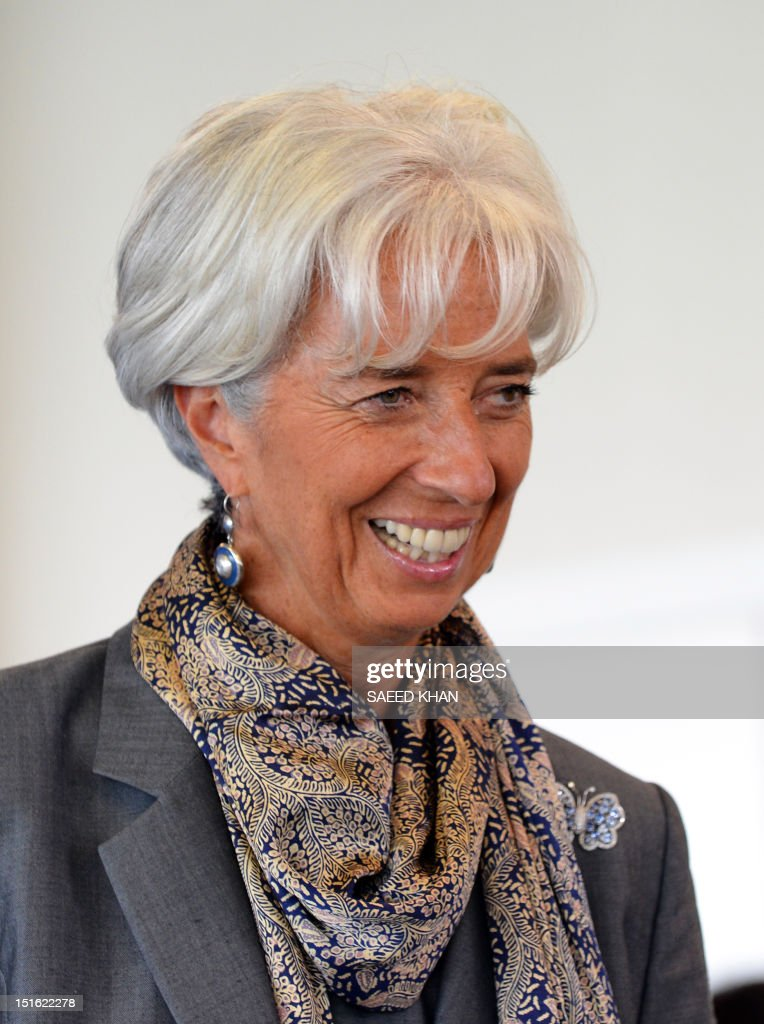 International Monetary Fund (IMF) chief Christine Lagarde smiles during a press conference after the Asia-Pacific Economic Cooperation (APEC) summit in Russia's far eastern port city of Vladivostok on September 9, 2012. AFP PHOTO / Saeed Khan