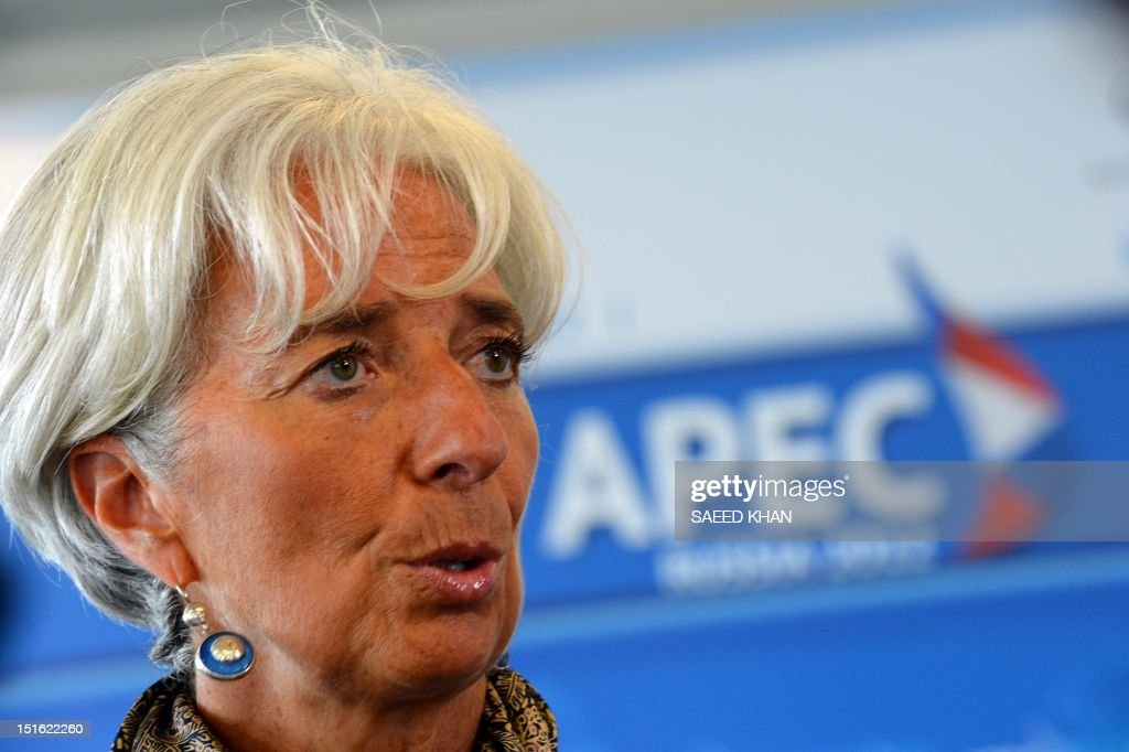 International Monetary Fund (IMF) chief Christine Lagarde speaks with the media after the Asia-Pacific Economic Cooperation (APEC) summit in Russia's far eastern port city of Vladivostok on September 9, 2012. AFP PHOTO / Saeed Khan