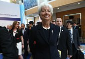 International Monetary Fund chief Christine Lagarde walks after a group photo with G20 finance ministers and central bank governors in Ankara on...