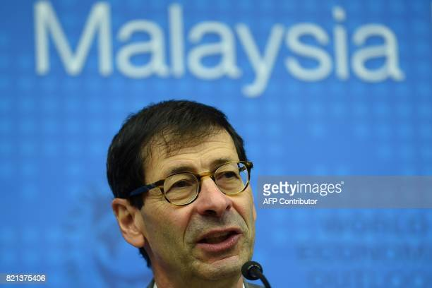 International Monetary Fund chief economist Maurice Obstfeld answers questions from the members of the media in Kuala Lumpur on July 24 2017 The...