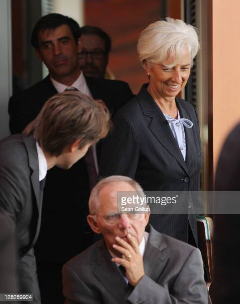 International Monetary Fund Director Christine Lagarde and German Finance Minister Wolfgang Schaeuble arrive for talks among world finance leaders at...