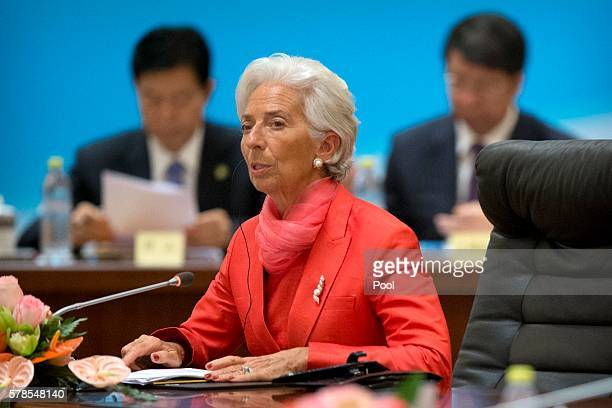International Monetary Fund director Christine Lagarde center speaks during the 16 Roundtable on promoting growth in the Chinese and global economies...