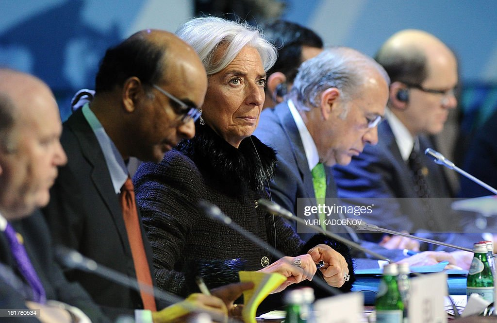 International Monetary Fund (IMF) Managing Director Christine Lagarde (C) attends a meeting of G20 states finance ministers and central bank governors' deputies in Moscow, on February 16, 2013. The ministers and central bank governors' deputies gathered today in Moscow for their first meeting in the Russian capital aimed at reassuring markets that the world's economic powers would not slug it out in 'currency wars' to boost national growth. AFP HOTO/YURI KADOBNOV