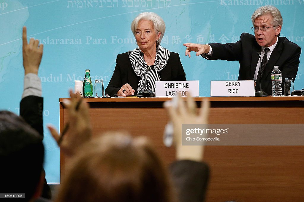 International Monetary Fund Managing Director <a gi-track='captionPersonalityLinkClicked' href=/galleries/search?phrase=Christine+Lagarde&family=editorial&specificpeople=566337 ng-click='$event.stopPropagation()'>Christine Lagarde</a> (L) and External Relations Director <a gi-track='captionPersonalityLinkClicked' href=/galleries/search?phrase=Gerry+Rice+-+Communications+Director&family=editorial&specificpeople=15283135 ng-click='$event.stopPropagation()'>Gerry Rice</a> hold a news conference at the IMF headquarters January 17, 2013 in Washington, DC. Lagarde called the conference to discuss the IMF's economic policy priorities for the coming year.