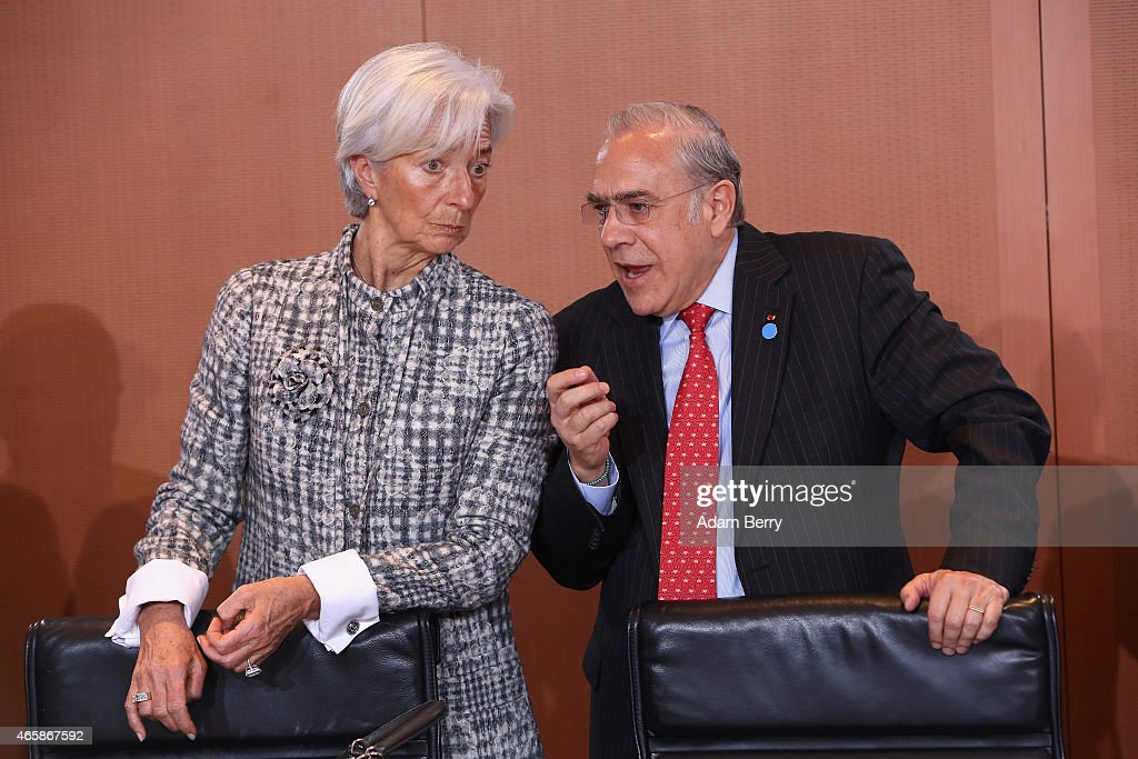 International Monetary Fund Managing Director <a gi-track='captionPersonalityLinkClicked' href=/galleries/search?phrase=Christine+Lagarde&family=editorial&specificpeople=566337 ng-click='$event.stopPropagation()'>Christine Lagarde</a> (L) and Organisation for Economic Cooperation and Development Secretary-General Angel Gurria speak to one another as they arrive for a meeting at the German federal Chancellery on March 11, 2015 in Berlin, Germany. Heads of the world's leading economic and financial organizations are meeting with the German chancellor to discuss several current issues including the crisis in Ukraine, the impending threat of financial meltdown in Greece and developments in the other eurozone economies, as Germany chairs the Group of Seven leading industrial nations this year.