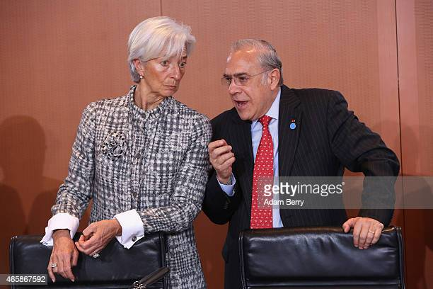 International Monetary Fund Managing Director Christine Lagarde and Organisation for Economic Cooperation and Development SecretaryGeneral Angel...