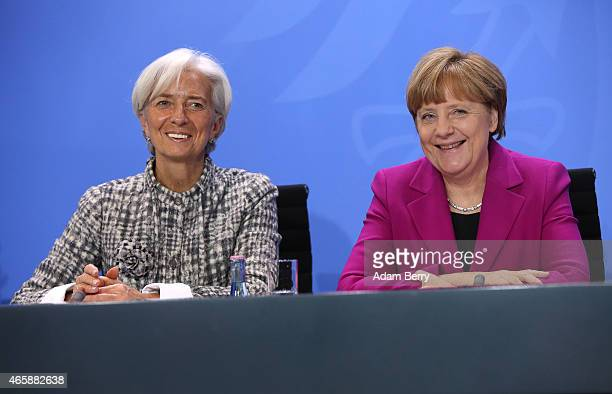 International Monetary Fund Managing Director Christine Lagarde and German Chanceller Angela Merkel attend a press conference at the German federal...