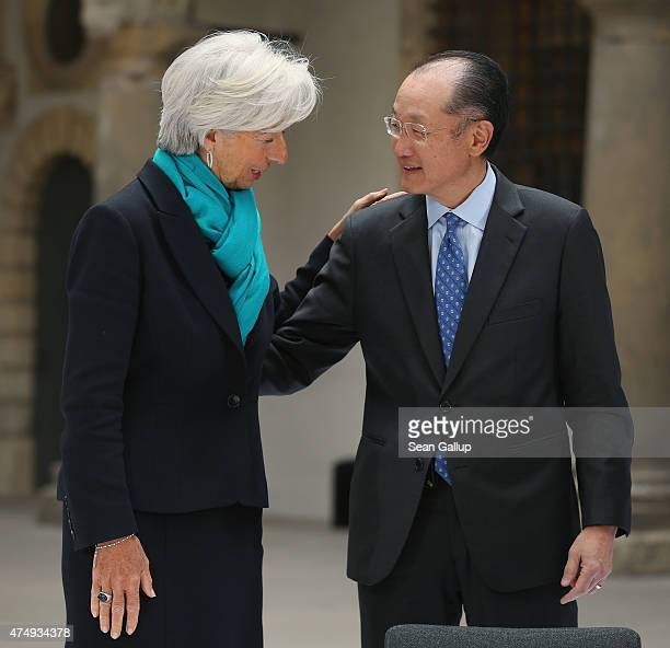 International Monetary Fund Managing Director Christine Lagarde and President of the World Bank Group Jim Yong Kim chat prior to the group photo of...