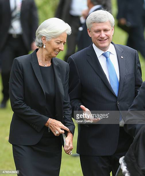 International Monetary Fund Managing Director Christine Lagarde and Canadian Prime Minister Stephen Harper arrive for the Outreach group photo on the...