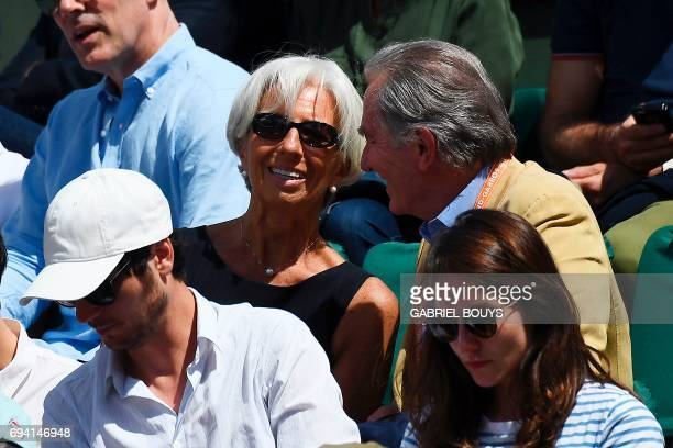 International Monetary Fund Managing Director Christine Lagarde and TV host William Leymergie attend the semifinal tennis match between Switzerland's...