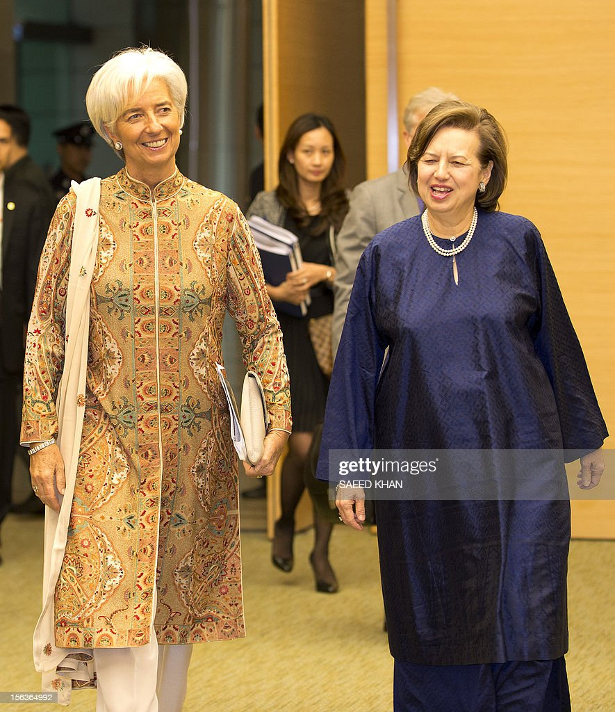 International Monetary Fund Managing Director Christine Lagarde (L) arrives for a joint press conference along with Malaysian Central Bank Governor Zeti Akhtar Aziz in Kuala Lumpur on November 14, 2012. Lagarde is visiting Malaysia to hold talks with the country's leadership on regional and global economic issues. AFP PHOTO / Saeed KHAN