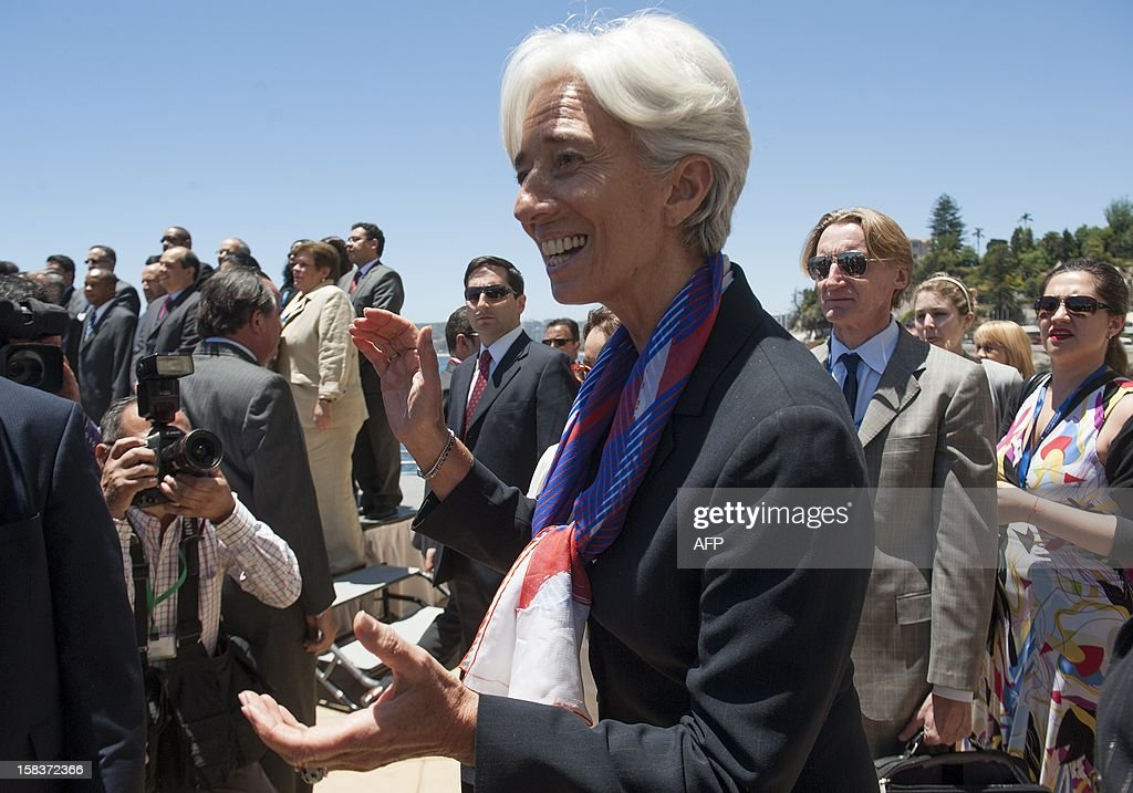 International Monetary Fund (IMF) Managing Director Christine Lagarde (R) jokes with journalists at the end of the family picture of the Community of Latin American and Caribbean States (CELAC) summit on December 14, 2012 in Vina del Mar, Chile. AFP PHOTO / Claudio SANTANA