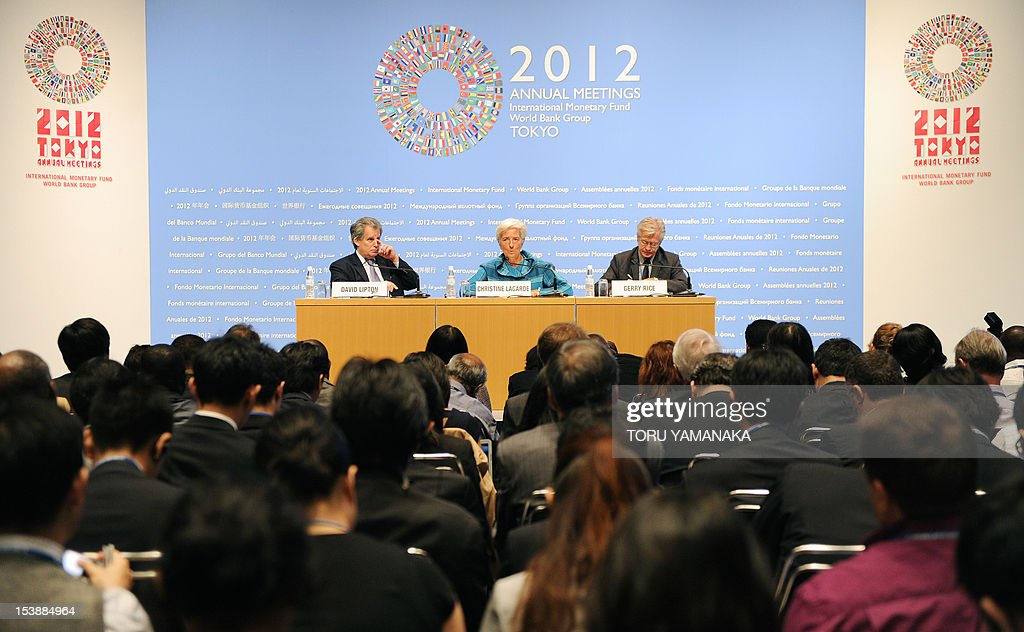 International Monetary Fund (IMF) managing director Christine Lagarde (C) answers questions while the IMF's first deputy managing director David Lipton (L) and external relations department director Gerry Rice (R) look on at a press conference during the annual meetings of the IMF and the World Bank in Tokyo on October 11, 2012. Greece's badly stressed economy will need a further two years before it is righted, the International Monetary Fund's managing director said in Tokyo. Lagarde told the news conference it would take time before Athens is able to reduce its deficit to agreed levels. AFP PHOTO / Toru YAMANAKA