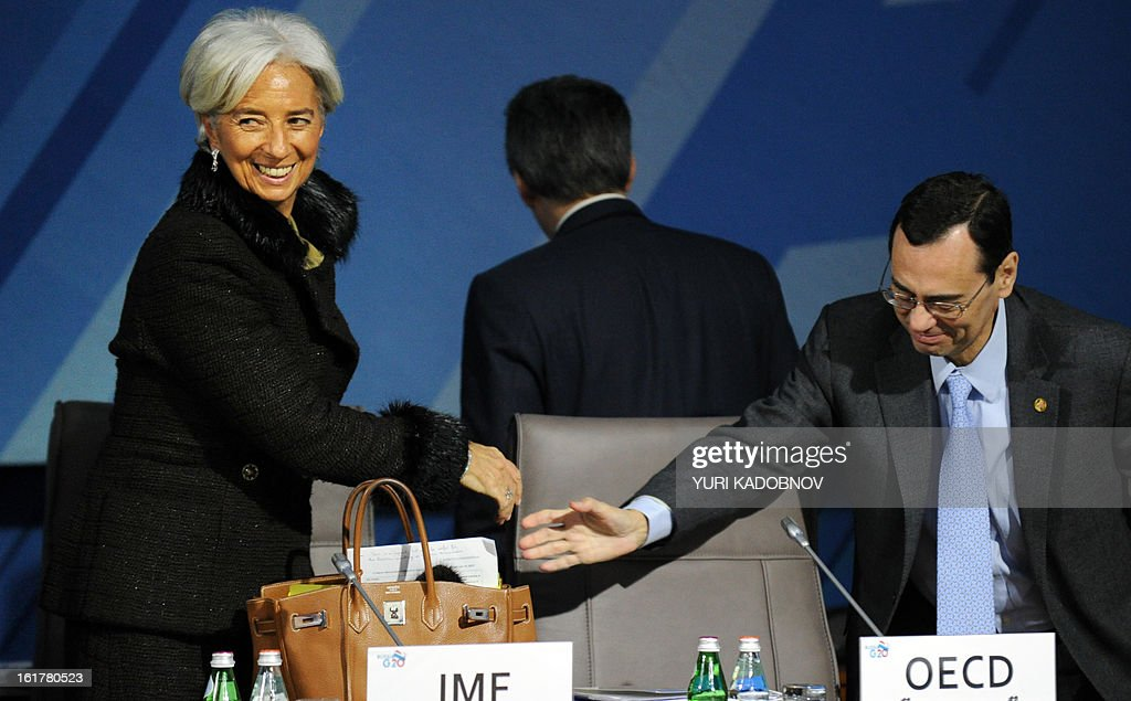 International Monetary Fund (IMF) Managing Director Christine Lagarde (L) shakes hands with Jaime Caruana (R), general manager of the BIS (Bank for International Settlements) as they attenda meeting of G20 states finance ministers and central bank governors' deputies attend their meeting in Moscow, on February 16, 2013. The ministers and central bank governors' deputies gathered today in Moscow for their first meeting in the Russian capital aimed at reassuring markets that the world's economic powers would not slug it out in 'currency wars' to boost national growth. AFP HOTO/YURI KADOBNOV