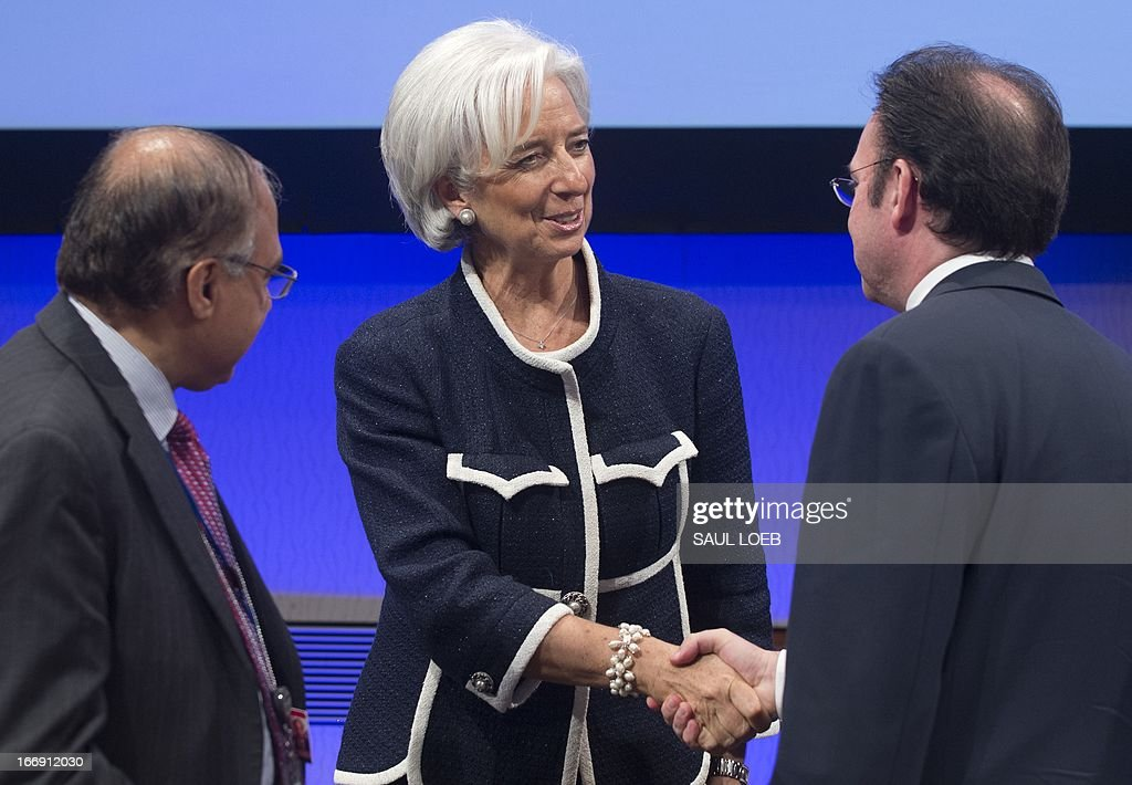 International Monetary Fund (IMF) Managing Director Christine Lagarde shakes hands with Mexican Secretary of Finance and Public Credit Luis Videgaray Caso, chairman of the IMF G-24 prior to a meeting at the IMF Headquarters in Washington, DC, on April 18, 2013, during the IMF/World Bank Spring Meetings. AFP PHOTO / Saul LOEB