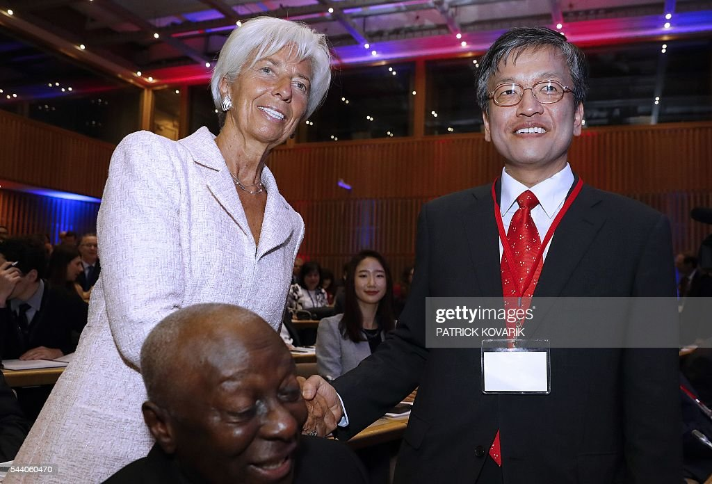 International Monetary Fund (IMF) Managing Director Christine Lagarde (L) shakes hands with Korean vice-minister of strategy and finance Sang Mok Choi during 60th anniversary of the Paris Club, on July 1, 2016 in Paris. KOVARIK