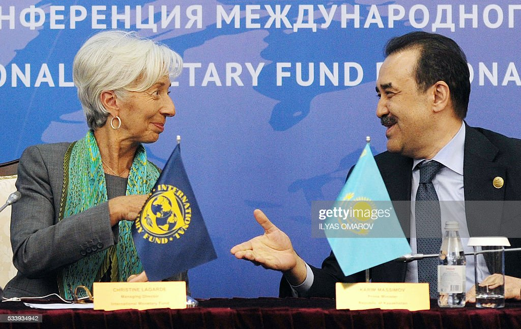 International Monetary Fund (IMF) Managing Director Christine Lagarde (L) approaches to shake hands with Kazakhstan's Prime Minister Karim Massimov during an IMF regional conference within the framework of the Astana Economic Forum, in Astana on May 24, 2016. / AFP / Ilyas Omarov