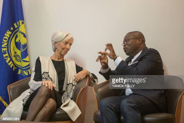 International Monetary Fund Managing Director Christine Lagarde listens to Benin Minister of Finance Romuald Wadagni upon her arrival in Cotonou on...