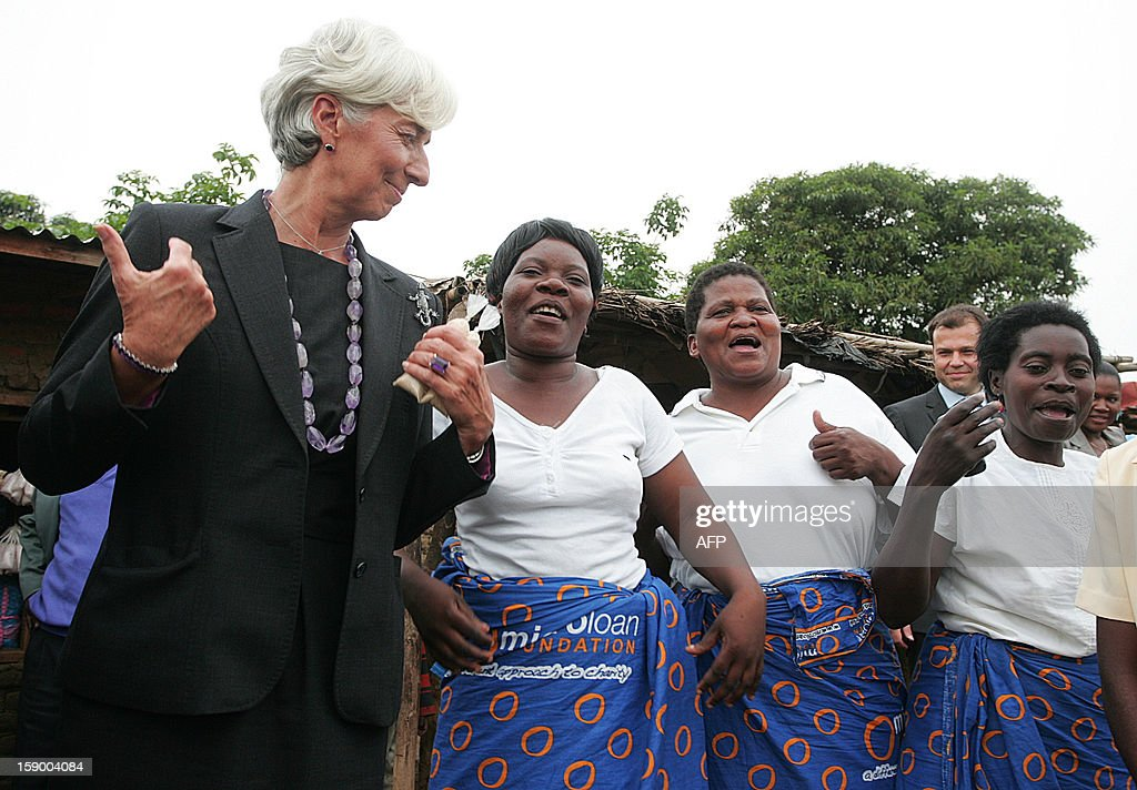 International Monetary Fund Managing Director Christine Lagarde dances with members of MicroLoan Foundation supported women's business groups, at Kasengere village in the suburb of Malawi's capital Lilongwe, on January 5, 2013. The MicroLoan Foundation, which receives funds from the International Monetary Fund, distributes them to three local non-profit groups - Nteza, Angola, and Chisangalalo - which help empower women to start small business initiatives. Lagarde urged Malawi to diversify its economy, saying a reliance on agriculture left the country's economic recovery under President Joyce Banda vulnerable. Lagarde is on a three day visit to Malawi from January 4 to January 6.