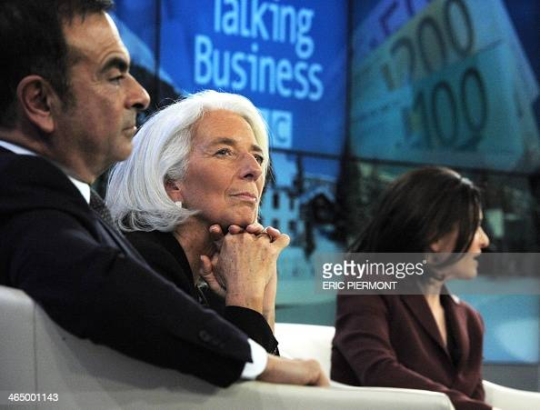 International Monetary Fund Managing Director Christine Lagarde listens with other session participants among them RenaultNissan CEO Carlos Ghosn and...
