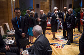 International Monetary Fund ManagingDirector Christine Lagarde chats with Singapore's Deputy Prime Minister Tharman Shanmugaratnam and Italy's...