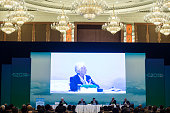 International Monetary Fund ManagingDirector Christine Lagarde is pictured on a large video screen as she takes part in the G20 Highlevel Tax...