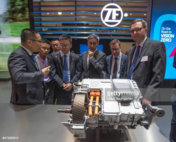 International Motor Show 2017 in Frankfurt Chinese and German carmanagers at an electric motor of the automotive supplier ZF Friedrichshafen