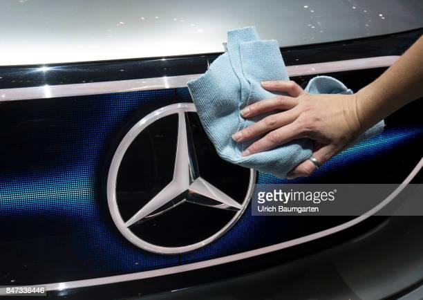 International Motor Show 2017 in Frankfurt Hand with a cloths cleans the MercedesBenz logo