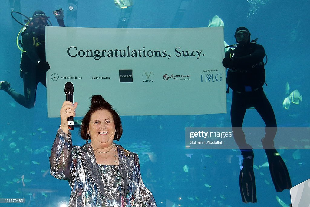 International New York Times International Fashion Editor Suzy Menkes smiles after a toast at a gala in her honour on November 21 2013 in Singapore...