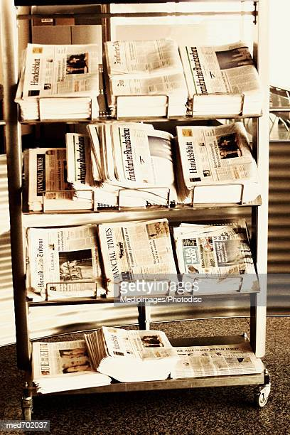 International newspapers on rack, close-up, part of
